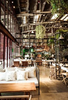 Bangkok Warehouse Goes Green for Terrarium-Inspired Restaurant - http://freshome.com/terrarium-inspired-restaurant/