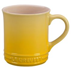 le crueset mug in yellow omg I want this so bad to complete my set