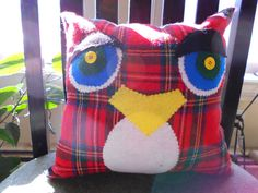 """This is  alisting for a pair of  owl pillows I made up from an old red plaid skirt. They  measure about  10.5"""" wide by 11"""" tall each.   Their bodies are  red, black, white, yellow and blue plaid.    Their  eyelids are  from scraps of charcoal grey wool blend pants.    Their  eyes are made from white, blue  and green felt with yellow button centers.    Their beaks are a scrap of yellow felt. Their chests are white felt.     Their bodies are  machine sewn on 3 sides. All other sewing is done…"""