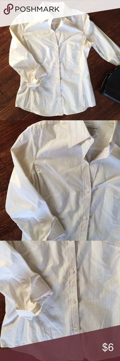 Banana Republic Button Down Cream button down with tan lines, small tan on bottom, shown in last picture. Letting this one go for a STEAL!!! Banana Republic Tops Button Down Shirts