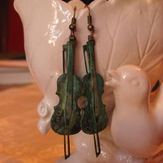 Music to my Ears- verdigris violin earrings. $12.00, via Etsy.