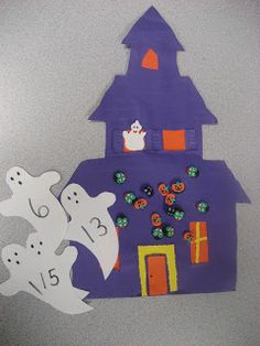 """Haunted House Math Learning Center (from Kinder Doodles; Students chose a ghost, read the number, count out appropriate number of """"creatures"""" to place onto the house)"""