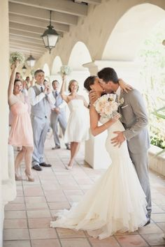 Love the brides dress; wedding decoration inspiration. Color scheme - light pink, white, greys for men.