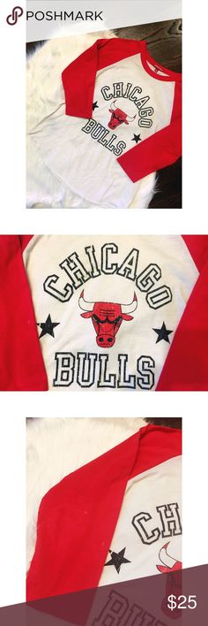 Chicago Bulls NBA Mitchell & Ness Baseball T-shirt Chicago Bulls NBA Mitchell & Ness WOMEN Red & White Baseball T-Shirt ( raglan T-Shirt) . Made and Designed by Mitchell & Ness. Screen Printed on the front is a Chicago Bulls logo. Top Quality Women's Polyester Blend 3/4 Sleeve Soft Baseball T-Shirt. 100% Authentic. Officially Licensed NBA Product. **It does have a small flaw, on one sleeve. Its 3 little bleach specs you can barely tell. See third picture. I did reduce the price for that…