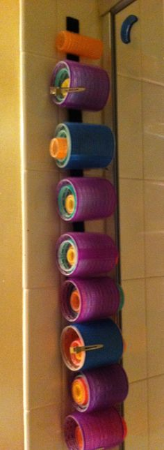 a cool way to organize velcro rollers- I put the fuzzy part of an adhesive velcro strip and put it on the tile so it's easy to take down