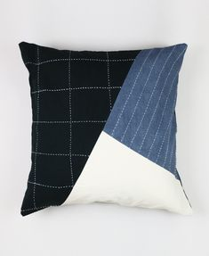 This throw pillow features vibrant geometric patchwork with contemporary embroidered accents. Colorblocks of contrasting patterns make it a vibrant addition to any space. Add a touch of visual luxury to your home decor with this hand-stitched organic cotton pillow.