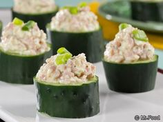Easy Cucumber Cups - We stuffed cucumbers with a low-fat ham salad, making this low-carb treat even better! Make a batch of these for your next healthy picnic and watch 'em go crazy over these!