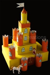 For our castle we collected cardboard boxes of different size, and toilet paper tubes. Using those building blocks, paint and some colored paper, we created this castle with floors, round towers, windows and a cone-shaped roof.  A flag from a toothpick and piece of paper is the final touch
