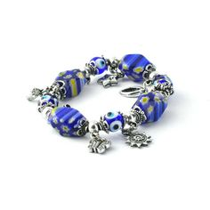 This Anatolian, Evil Eye Elastic Charm Bracelet - Blue Transparent Flower Glass Ornament measures 3 inches wide and features hand-crafted glass evil eyes.