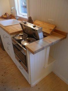 22' long Ynez tiny house by Oregon Cottage Company - the marine oil-fueled stove is by Origo