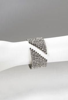 10 Row open cuff rhinestone bracelet features:• 10 Row open cuff rhinestone bracelet• Lead and nickel free