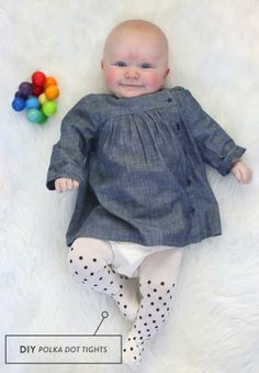 Adorable DIY polka dot baby tights! Use Avery reinforcement labels for the perfect circle.