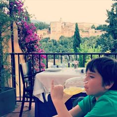 Table with a view of the Alhambra If you ask a cab driver to take you to Plaza De Saint Nicolas you will be taken up some very narrow and windy roads that put you directly across from the Alhambra which has the best view! El Huerto de Juan Ranas Restaurant and Hotel is right below this plaza and if you want to dine and watch the sunset while taking in the view, this is a great place! It is not cheap, but we had a spectacular view.