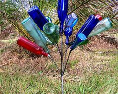 """Southern Garden BOTTLE TREE - 16 Wine Bottle Yard Art Bottletree - The tree """"Ball"""" measures up to approx. inches diameter and inches from ground approx.(Depending how you bend the branches and bottle sizes) Wine Bottle Trees, Wine Bottle Crafts, Wine Bottles, Wine Bottle Garden, Glass Bottles, Blue Bottle, Bottle Art, Bottle Torch, Diy Bottle"""