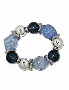 "Exceed all expectations in this fun and flirty stretch bracelet. Created with luminous light blue and navy blue lucite nuggets accented with silver-colored swirled lucite rings and silvertone beads between each station. Perfect for day or evening wear. Expandable 8"" length. sonsi.com"