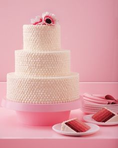 Ombre layers of red velvet cake are covered with beads of cream cheese buttercream for a charmingly retro look with a delicious homemade quality.