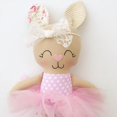 This beautiful handmade bunny doll is made with love! She is about 15 inches tall not including her ears and made from high quality cotton fabrics. Her face is hand embroidered and detailed with cute rosy cheeks and a pink nose. Her tutu and headband are removable. Contact me if