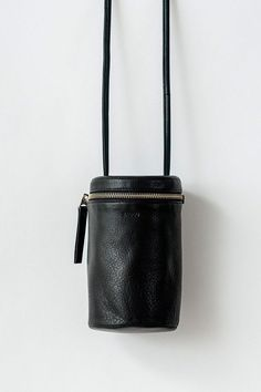 A cylindrical leather cross body purse in the softest leather. Top zipper  closure and adjustable c164524305e52