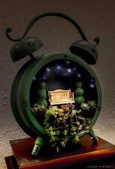 The cutest little clock fairy garden. Includes full plans for making the porch swing and the miniature topiary trees diy garden plants How to Make a Clock Fairy Garden and Porch Swing Fairy Garden Furniture, Fairy Garden Houses, Fairies Garden, Plants For Fairy Garden, Fairy Gardening, Mini Fairy Garden, Gnome Garden, Garden Roses, Make A Clock