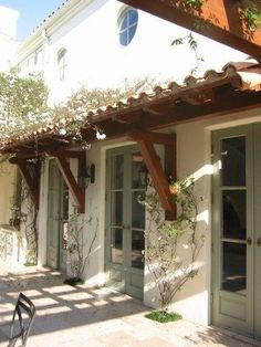 Spanish style home with bracketed roof over french doors. - Line Phi - Spanish style home with bracketed roof over french doors. Spanish style home with bracketed roof over french doors. Best Exterior Paint, Exterior Paint Colors For House, Paint Colors For Home, Exterior Colors, House Colors, Exterior Design, Paint Colours, Stucco Colors, Exterior Homes