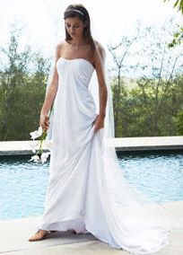 Redefine belle of the ball in this Grecian-inspired long, soft and flowing wedding dress.   Elegant strapless sweetheartchiffon sheath features an intricately beaded neckline.  Empire waist promises a gorgeous silhouette.  Woman: Style 9WG3481, sizes 16W-26W,   Sizes 0-14. Available in White in stores. Ivory by Special Order.  Sweep train. Fully lined. Back zip. Dry clean only.  To preserve your wedding dreams, try our Wedding Gown Preservation Kit.