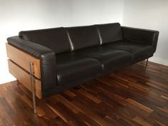 Habitat-Robin-Day-Forum-Dark-Brown-Leather-And-Wood-3-Seater-Sofa. WE HAVE ONE OF THESE AT THE MOMENT
