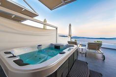 Take a dip in your private hottub or infinity pool at Santorini Secret Suites and Spa