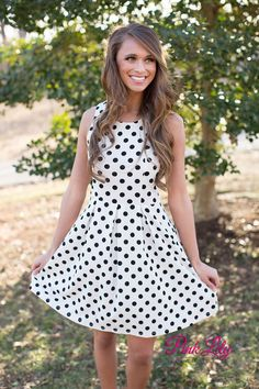 Have the cutest look in town with this Back In Time Polka Dot Dress! It features small black polka dots, a racer back, textured material, and an elastic band around the waist! Where this out with the girls or for a night on the town!