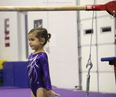 Patiently waiting to start a bar routine. Gymnastics