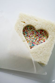 A fun treat for a Valentine's lunch box.  Just add a cutout and sprinkles to a PB & J (or at our house, a cream cheese and jelly) sandwich.---Doing this for my love, nick