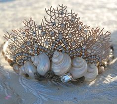 Beach loving princesses will swoon over The Mermaid's Palace seashell tiaras. Using authentic seashells, pearl beads, rhinestones, and other pieces, artist Kari Jeanne Lobdell adorns fabric wrapped metal tiara bands so they can be molded to fit any sized