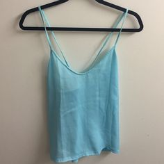 Light blue tank top blouse Light blue tank top blouse with crossing straps in the back! Scooped next in the front and a tad sheer. Great condition and perfect for summer! Zara Tops Blouses
