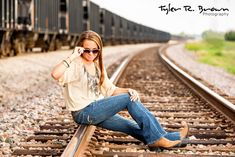 Hannah sits on the train tracks, in Frisco Square, and shows us some sass!