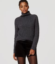 I'm not sure how shimmery it is... but I've looked for a chunky charcoal turtleneck since last winter.