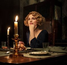 Queenie Goldstein looks thoughtful over dinner. - Fantastic Beasts and Where to Find Them