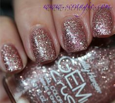 Sally Hansen Razzle Dazzler. A light rosy pink glitter with larger round silver glitter in a clear base.
