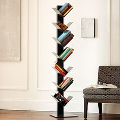 """A new direction in book storage. Angled shelves allow for the unique display of books, and the small footprint makes this a clever solution for smaller spaces.      • Metal with graphite powder-coated finish.    • Seven fixed, angled shelves for storage and display.    • 14""""w x 15""""d x 64.5""""h.    • Minimal assembly required.    • Wipe clean.    • Imported.    • Online/Catalog only."""