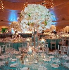 Beautiful Tiffany Blue tablescape with a tall centerpiece (INDOORS!!) of orchids.