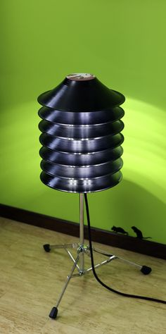 This floor lamp is made from upcycled vinyl records and a drum stand, perfect for a music lover!