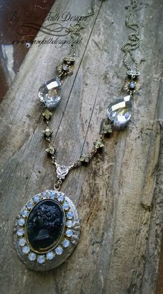 """A truly timeless design, features antique cameo with milky blue stone surround. Hanging from rosary connector, chain has crystal beads, brass flowers with blue stone centers and vintage rhinestone connectors. Long 32"""""""