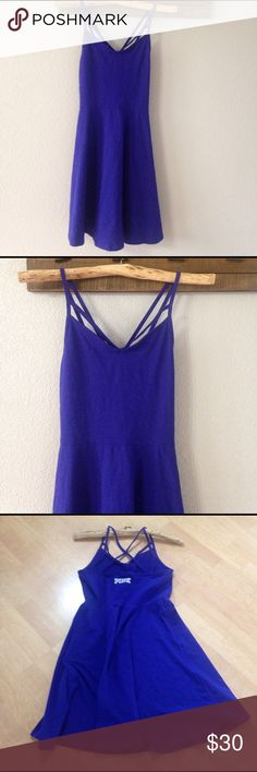 """NWT Victoria's Secret sexy little skater dress NWT Victoria's Secret sexy little skater dress makes a perfect addition to your spring break wardrobe! Can be worn alone or as a cover up over a bathing suit at the beach! White lettering """"PINK"""" @ back and strappy detailed @ front & back. Super comfy Material: 94% Cotton & 6% Elastane. Measures 34"""" in length. Color: Cobalt blue. Size Large. Ships same day of purchase. PINK Victoria's Secret Dresses"""