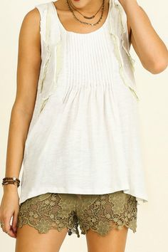 This Sleeveless High/Low Top with a pop of pale green in the ruffled edges is a Must Have! It pairs great with jeans for those casual Fridays at work and the day at the beach!   Sleeveless Ruffled Top by Umgee USA. Clothing - Tops Alabama