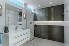 Modern Bathroom by H3K Design cureless shower with full length wall niche with LED lighting