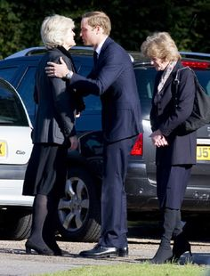 Prince William arrived at the service at Parndon Wood Cemetery accompanied by his late mother's sisters Lady Jane Fellowes (L) Lady Sarah McCorquodale (R) on 10 Oct 2012