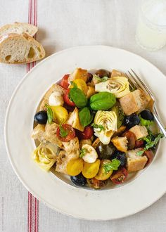 Panzanella with Artichokes and Olives   www.kitchenconfidante.com  Perfect without the mozzarella.