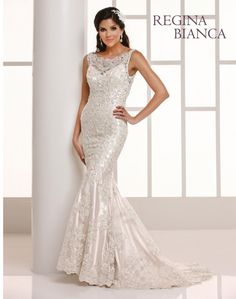 Regina Bianca  Style #RB1208  Glamorous re embroidered lace on net over satin sheath with trumpet skirt is a stunning gown for your most special day. It is gracefully accented with beads and sequins throughout. There is a beautiful bateau lace trimmed net yolk neckline, a cameo back, covered buttons, and chapel train.