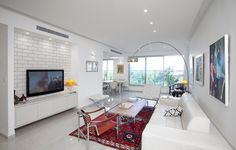 Contemporary apartment by TSLIL Designs