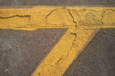 Yellow and grey, parking lot paint texture @theDarklit