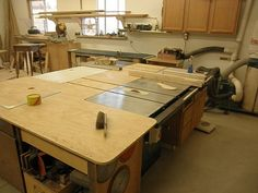 The center of the cabinet building universe is the table saw, but it is not much use without the proper material handling ability that must be added in the way of an outfeed table and a fence extension.