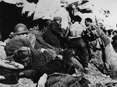Near Fraga, the Aragón front. Spain. Treating the wounded Republican soldiers during their offensive along the Río Segree. By Robert Capa, (November 7th, 1938)